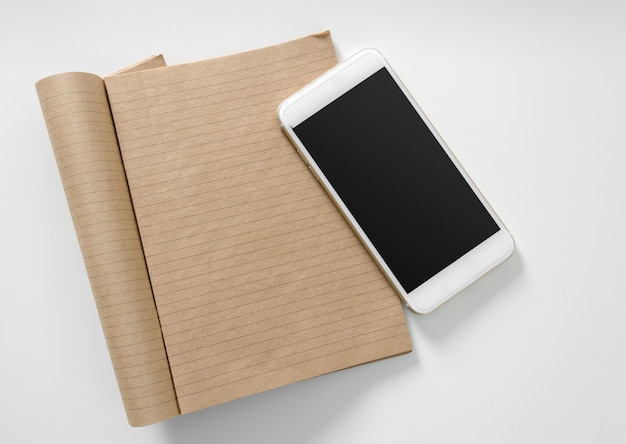 Blank motebook and smartphone