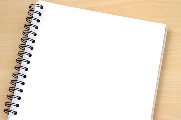 Blank note book paper on wood background, template