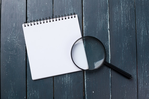 Blank note book on table, top view