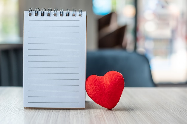 Blank note book with red heart shape
