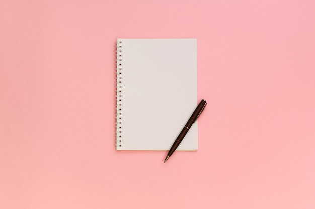 Blank note paper with pen on pink pastel background
