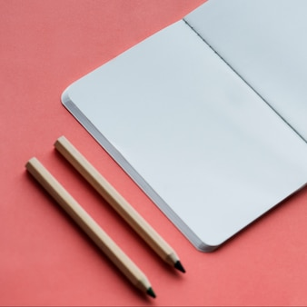 Blank notebook and pencil isolated on background