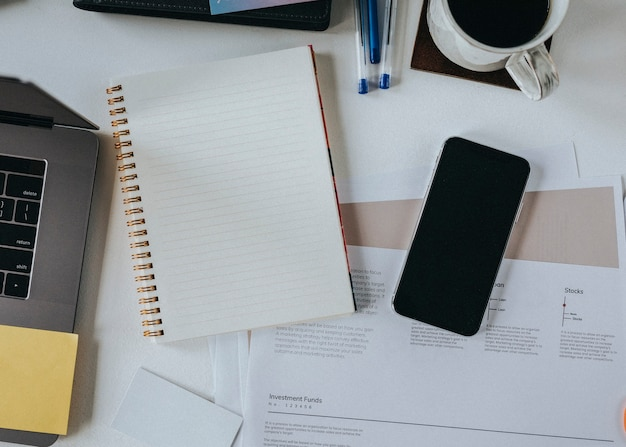 Blank notebook by a mobile phone