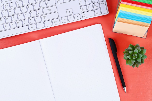 Blank notebook on coral background