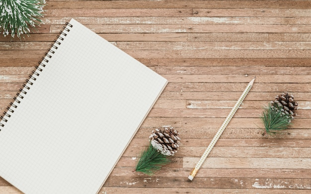 Blank notebook for mockup on wood for christmas background