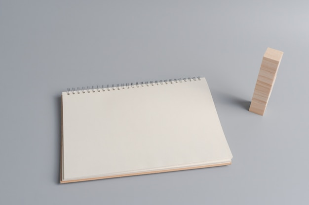 Blank notebook paper by wooden cube blocks