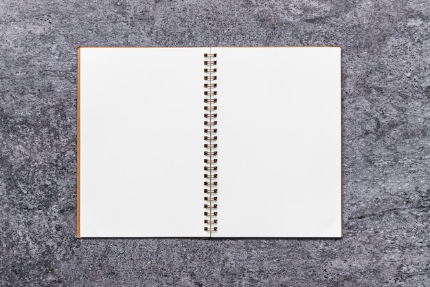 Blank notebook on table gray stone