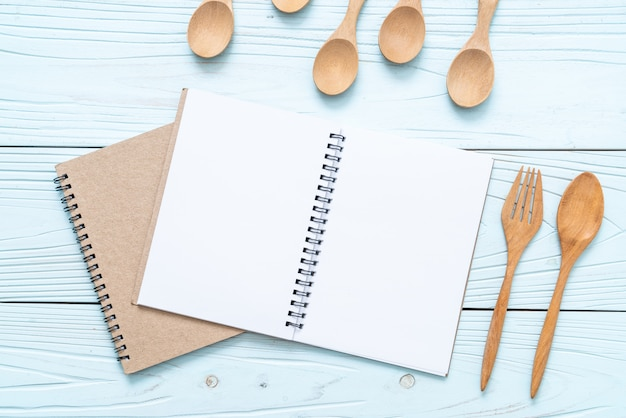 Blank notebook for text note on wooden surface with copy sapce
