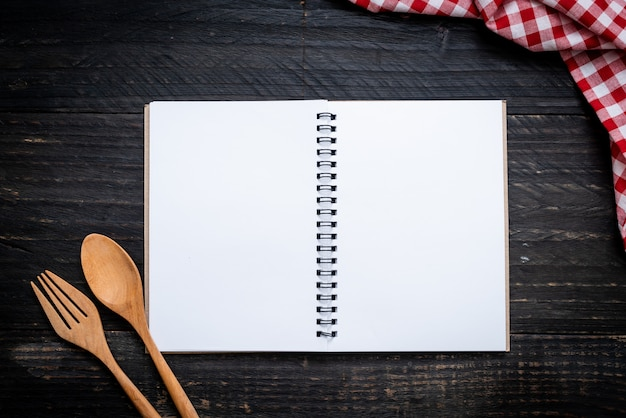 Blank notebook for text note on wooden surface