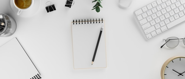Blank notebook on white desk with stationery and supplies 3d rendering 3d illustration top view