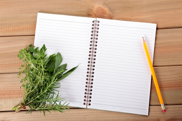 Blank notebook with a bunch of herbs