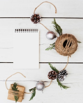 Blank notebook with christmas decorations around