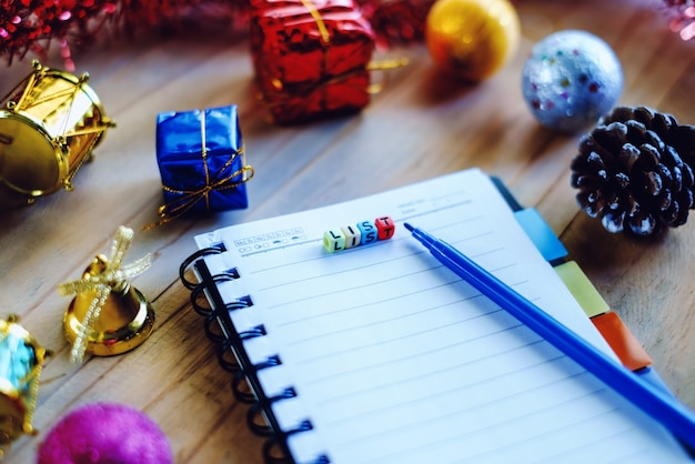 Blank notebook with christmas and new year ornaments on wooden table