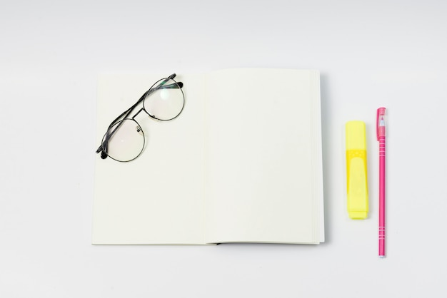 Blank notebook with glasses