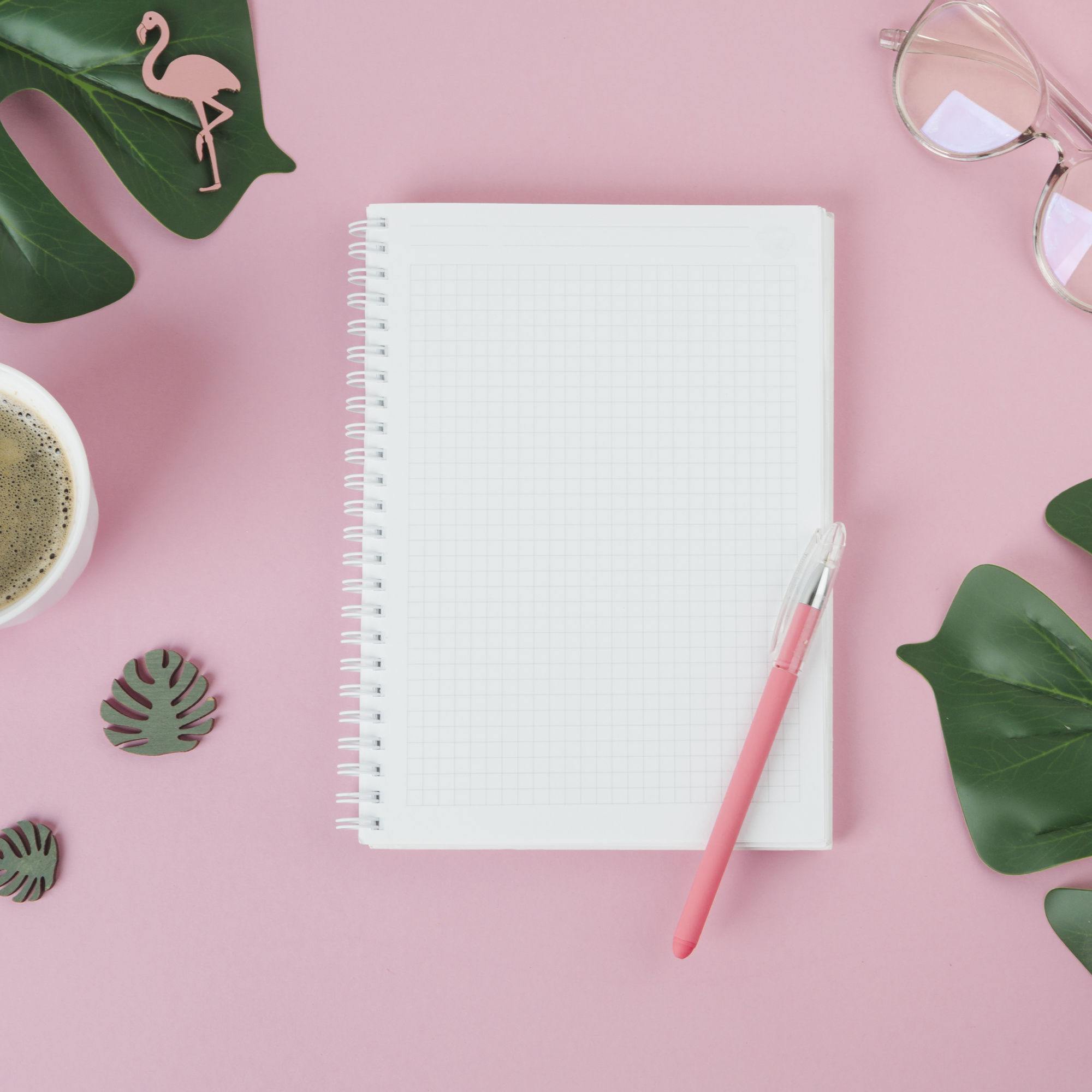 Blank notebook with pen on table