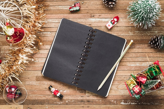 Blank notebook on wood with christmas ornaments