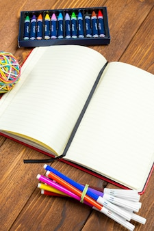 Blank notepad on office wooden table
