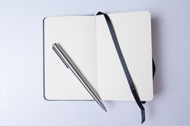 Blank notepad on white table ready to write