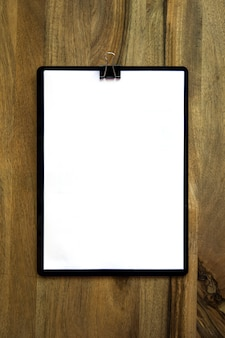 Blank notepad with copyspace on the wooden table