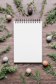 Blank notepad with green branches