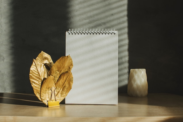 Blank notepad with shadows and hard light
