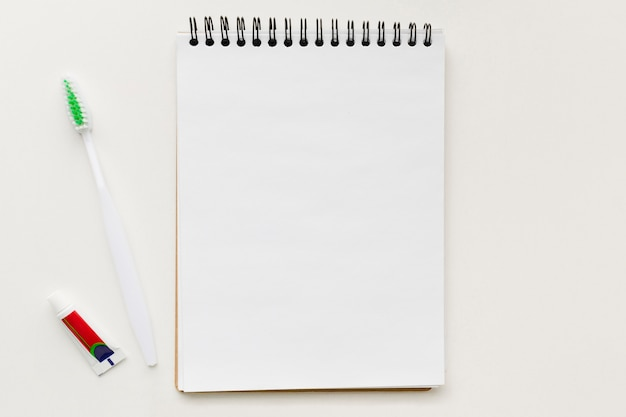 Blank notepad with tooth brush