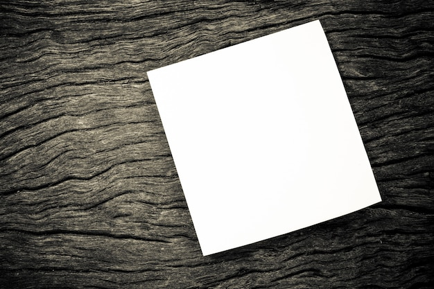 Blank notepad on wooden background