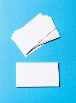 Blank office objects organized for company presentation on blue paper