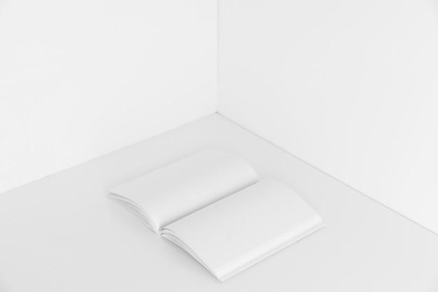 Blank open book in corner of room