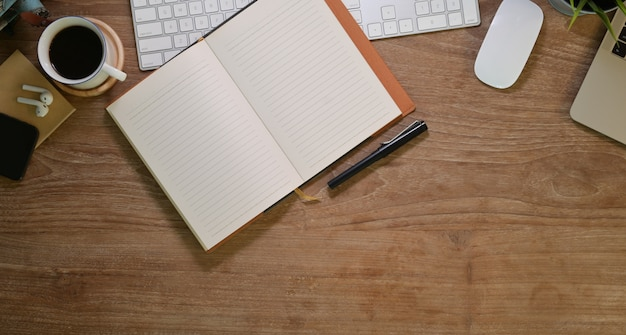 Blank open notebook in comfortable workplace with office