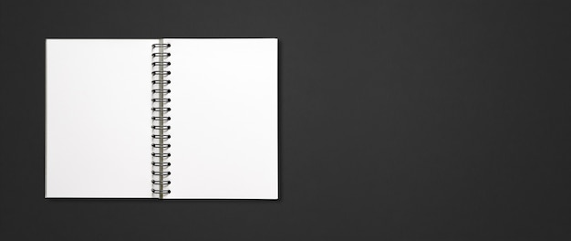 Blank open spiral notebook mockup isolated on black horizontal banner