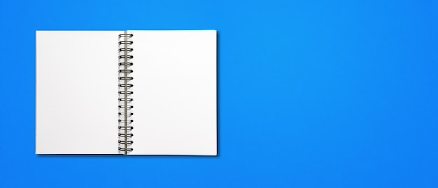 Blank open spiral notebook mockup isolated on blue horizontal banner