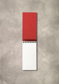 Blank open spiral notebook mockup isolated on concrete background