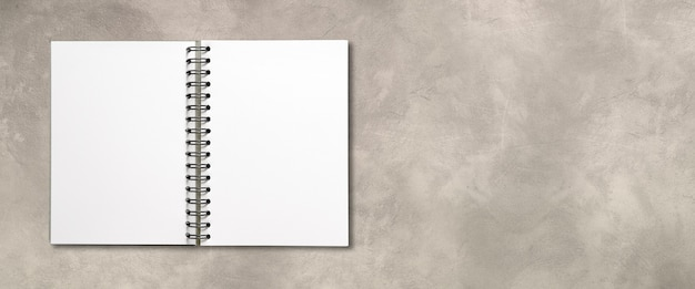 Blank open spiral notebook mockup isolated on concrete banner