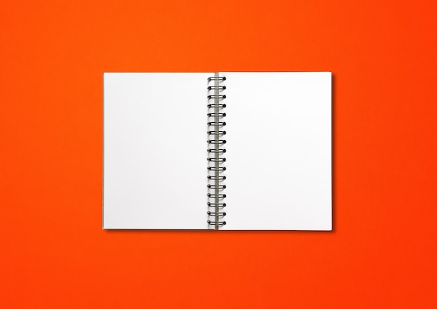 Blank open spiral notebook mockup isolated on red