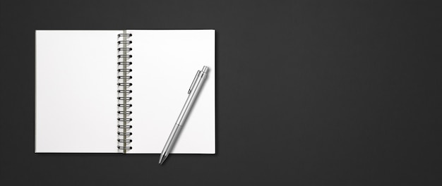 Blank open spiral notebook mockup and pen isolated on black horizontal banner