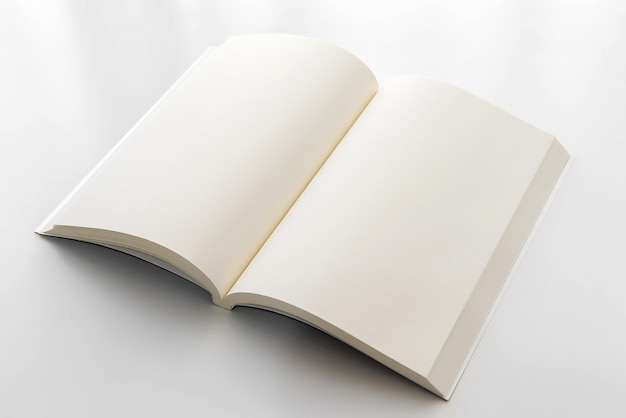 Blank opened book on white table