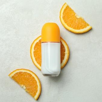 Blank orange deodorant on white textured background