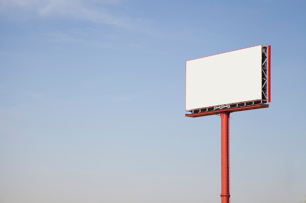 Blank outdoor advertising billboard hoarding against sky