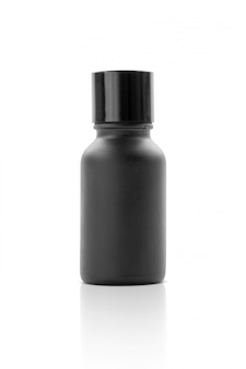 Blank packaging cosmetic serum black bottle isolated