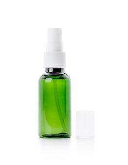Blank packaging green glass spray bottle for cosmetic or health care product design mock-up isolated on white background
