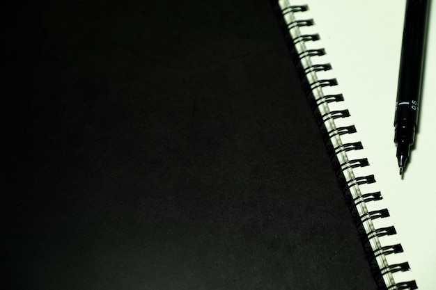 Blank page notebook and pen