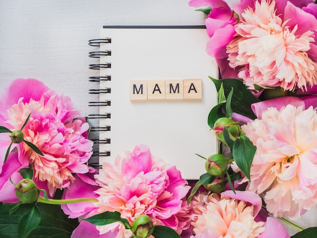 Blank page of the notebook with the word mama