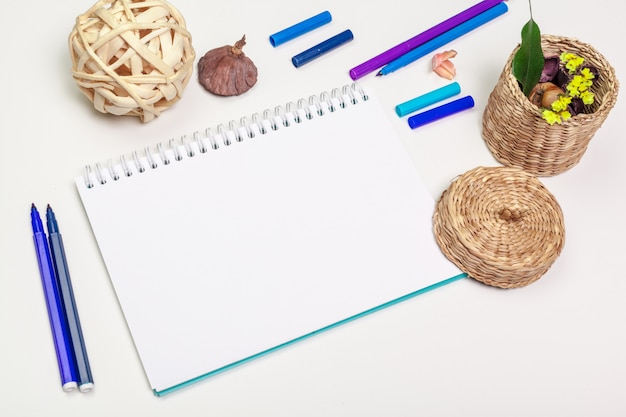 Blank page of spiral notepad on white table