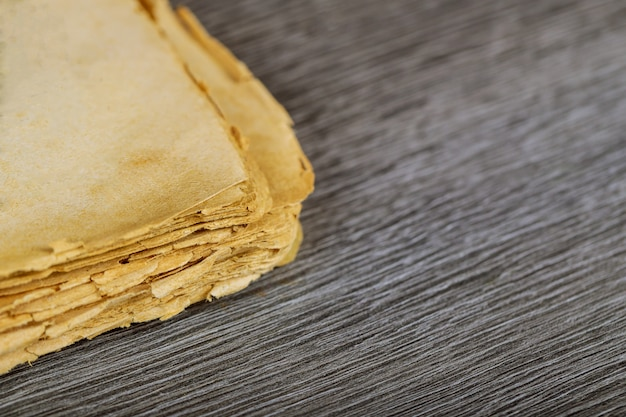 Blank pages of old book on wood background