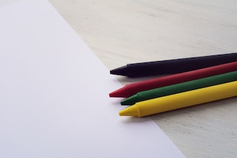 Blank paper and colorful crayons
