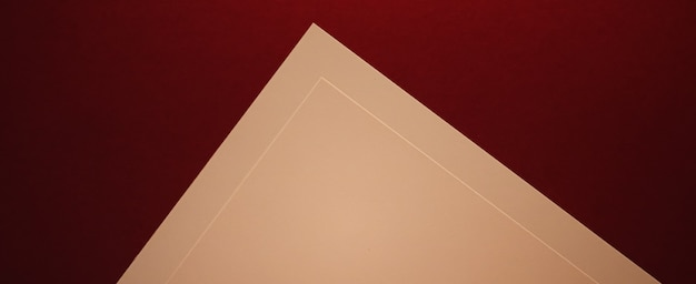 Blank a paper beige on dark red background as office stationery flatlay luxury branding flat lay and...
