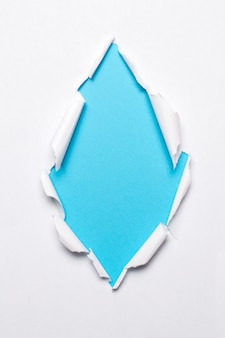 Blank paper on blue background