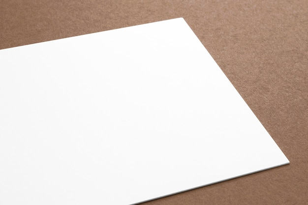 Blank paper card on carton background. close view 3d render.