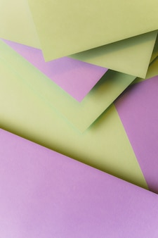 Blank paper cards layered over one another forming background